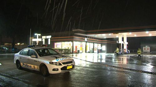 Two men wearing hoodies and armed with guns fled the Bankstown store with a small amount of cash. (9NEWS)