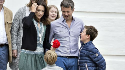 The royal family's dogs hovered at their feet during the shoot. (AAP)