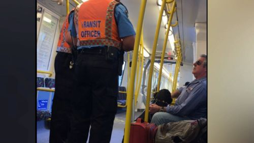 The guards were filmed asking the man about his dog. Picture: 9NEWS