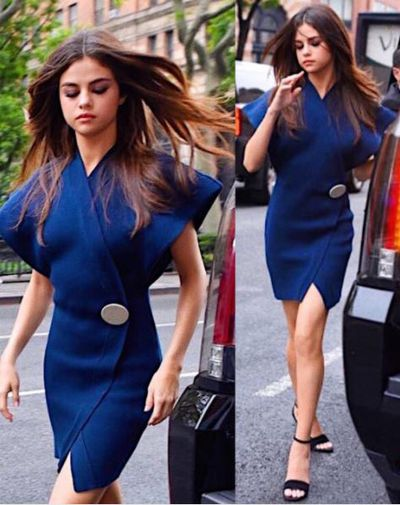 Selena Gomez showed off her flowing long locks as she stepped out in New York over the weekend in a blue wrap dress from designer Jacquemus.