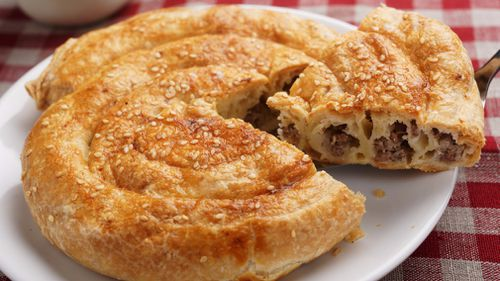 A mouth-watering meat strudel.