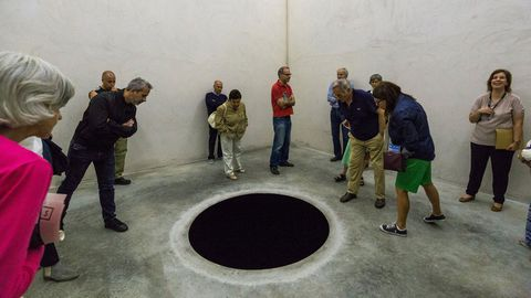A man in his 60s has been hospitalised after falling into in an art installation designed to look like a cartoon hole.