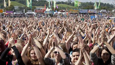 The crowd at Glastonbury Music Festival clap their hands above their heads as they watch Chipmunk on stage, on June 24, 2011 in Glastonbury, England