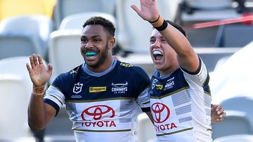 Hamiso Tabuai-Fidow of the Cowboys celebrates after scoring a try