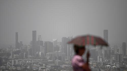 Brisbane skyline covered in smoke.