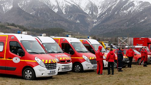 Emergency vehicles are lined up near the crash site. (AAP)