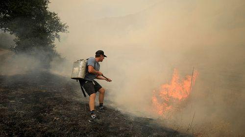 Tony Leonardini works on a spot fire  in Napa County, California. California Wildfires