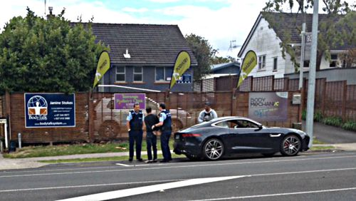 AC/DC drummer Phil Rudd is arrested outside Tauranga Girls' College on New Zealand's North Island. (SunLive.co.nz)