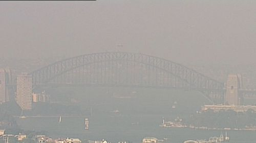 A haze of smoke swept over the Sydney Harbour yesterday.