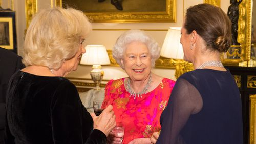 Queen Elizabeth II with the Duchess of Cornwall and Princess Zahra Aga Khan in the White Drawing Room at Windsor Castle. (AAP)