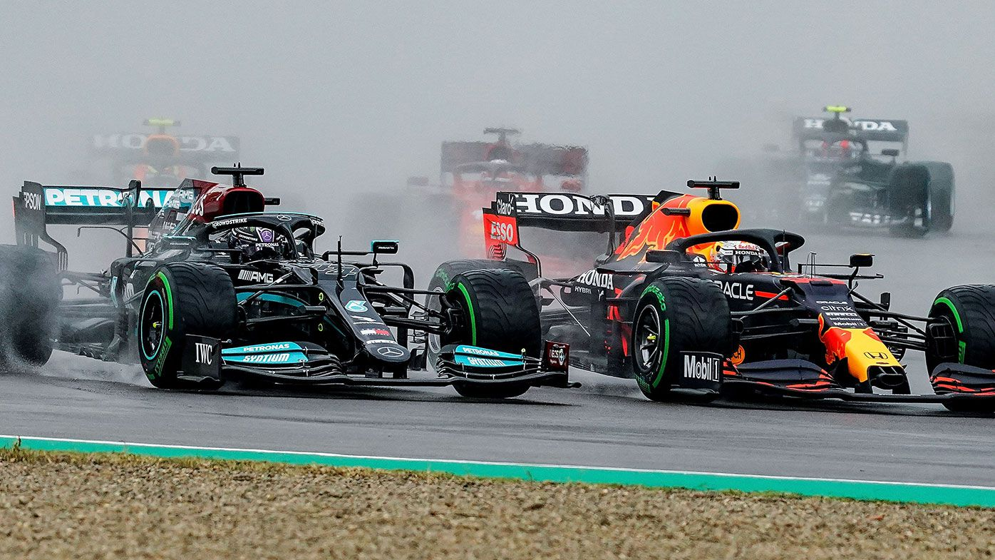 Lewis Hamilton and Max Verstappen battle at the start of the Imola race.