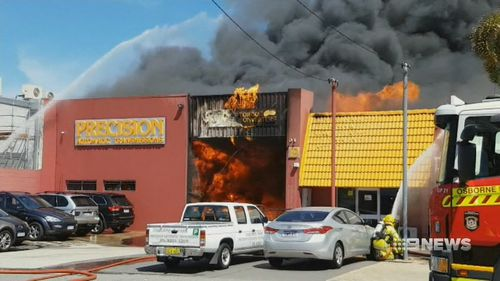 The teenager was 'horribly burnt' during the fire at the auto-shop. (9NEWS)