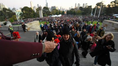 <p>Thousands of Aussies have gathered at Anzac Day memorial services nationwide and overseas today. <br><br>Crowds paused to remember lost and fallen soldiers, and pay tribute to those currently serving in our defence force.<br><br>Visitors lay poppies after the dawn service in Melbourne. (AAP)</p><p></p>