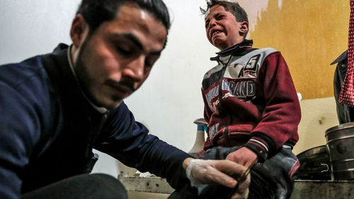 A child casualty receives treatment. (AP).