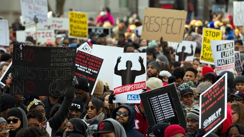 Demonstrators march on Pennsylvania Avenue toward Capitol Hill in Washington. (AAP)