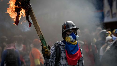 Protesters have continued to clash with police in opposition of the Maduro regime. (AFP)