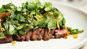 Thi Le's lamb backstrap with jungle mix and smoked rice powder