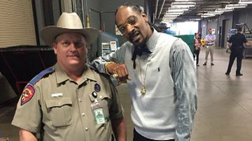 Police officer forced into counselling after taking photo with Snoop Dogg
