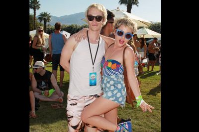 <i>Game of Thrones</i> star Alfie Allen shows off his blonde new do with girlfriend Jamie Winstone at Coachella's LACOSTE L!VE 4th Annual Desert Pool Party.