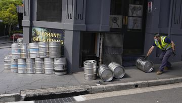 As businesses prepare to reopen in Sydney, there are concerns about what coming into contact with a case would mean for staff. Sydney lockdown ending pub bar kegs on September 21, 2021. (AP Photo/Mark Baker)