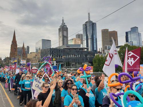 A sea of colour lined Melbourne's CBD streets today. (Kieran Jones)