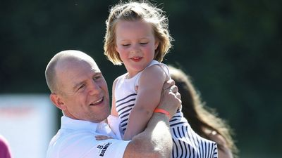 Mia Tindall with father Mike at a charity golf tournament, July 2018