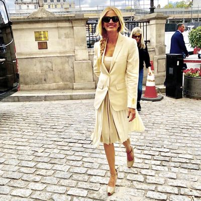 Roberts arrived at the hotel in a pleated beige, scoop-neck frock which flared at the waist. She paired the dress with a blazer of the same colour featuring gold buttons which matched her platinum blonde locks - pulled together in a pretty side braid.