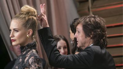 A cheeky Paul McCartney at the 2014 Vanity Fair Oscar Party on March 2, 2014 (Getty).