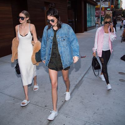 Kendall Jenner (pictured with Gigi Hadid and Hailey Baldwin) gives the trend athletic appeal with white sneakers.