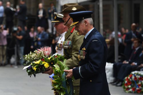 Representatives of the Australian Defence Forces prepare to lay wreaths during the Remembrance Day service at the Cenotaph in Sydney. (AAP)