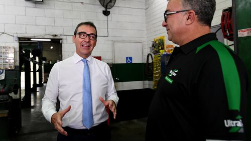South Australian Liberal leader Steven Marshall speaks to franchisee Rocky Carbone (right) during a visit to Ultra Tune Unley in Adelaide. (AAP)