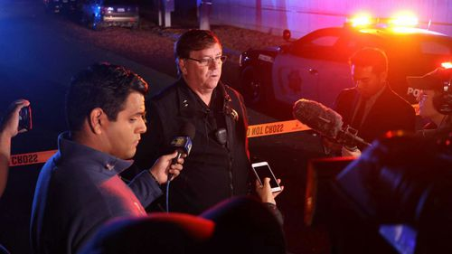 Fresno Police Lt Bill Dooley speaks to reporters at the scene of the shooting.