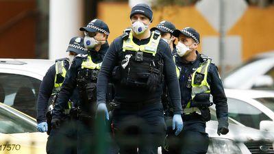 Victoria Police officers patrol locked down towers