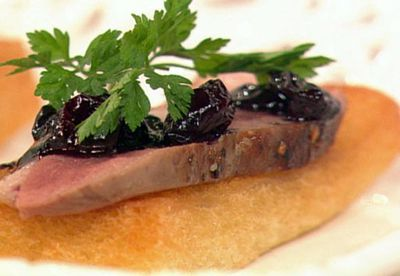 Seared rare duck breast with blueberry chutney