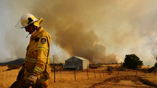 TUMURUMBA, AUSTRALIA - JANUARY 11: A Rural Fire Service firefighter Trevor Stewart views a flank of a fire on January 11, 2020 in Tumburumba, Australia. Cooler temperatures forecast for the next seven days will bring some reprieve to firefighters in NSW following weeks of emergency level bushfires across the state, with crews to use the more favourable conditions to contain fires currently burning. 20 people have died in the bushfires across Australia in recent weeks, including three volunteer f