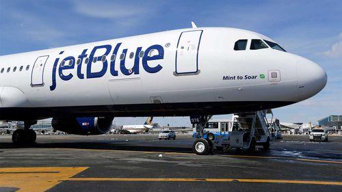 A jetBlue plane on the tarmac.