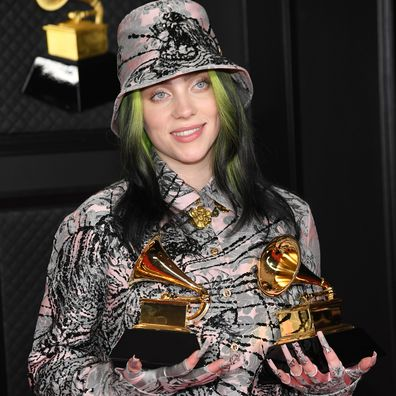 """Billie Eilish, winner of Record of the Year for 'Everything I Wanted' and Best Song Written For Visual Media for """"No Time To Die"""", poses in the media room during the 63rd Annual GRAMMY Awards."""