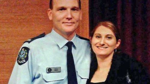 Anndrea Hocking (right) with husband Adrian during his days on the police force.