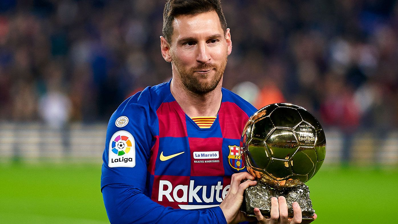 Lionel Messi of FC Barcelona holds up his sixth Ballon d'Or