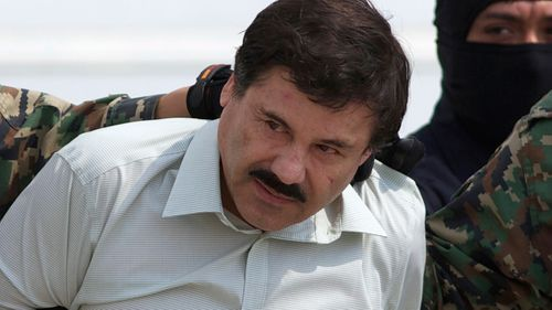 """Joaquin """"El Chapo"""" Guzman, the head of Mexico's Sinaloa Cartel, being escorted to a helicopter in Mexico City following his capture in the beach resort town of Mazatlan"""
