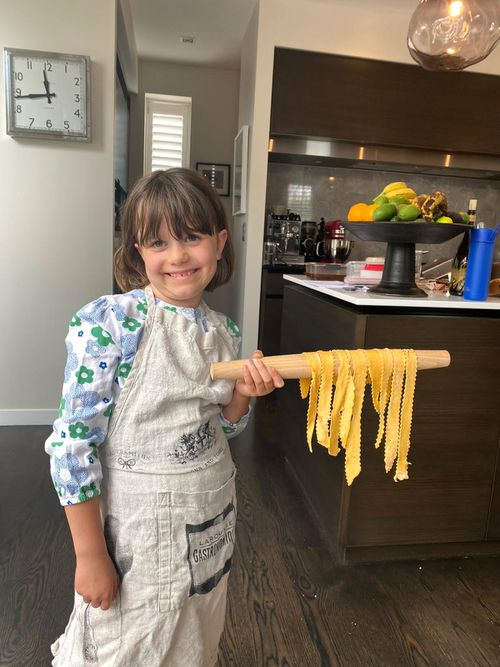 Gabriella Guise, pictured making pasta during a COVID-19 lockdown, was delighted when she found out there was no school.