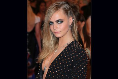 Young model Cara Delevingne rocked out in this low cut studded number.