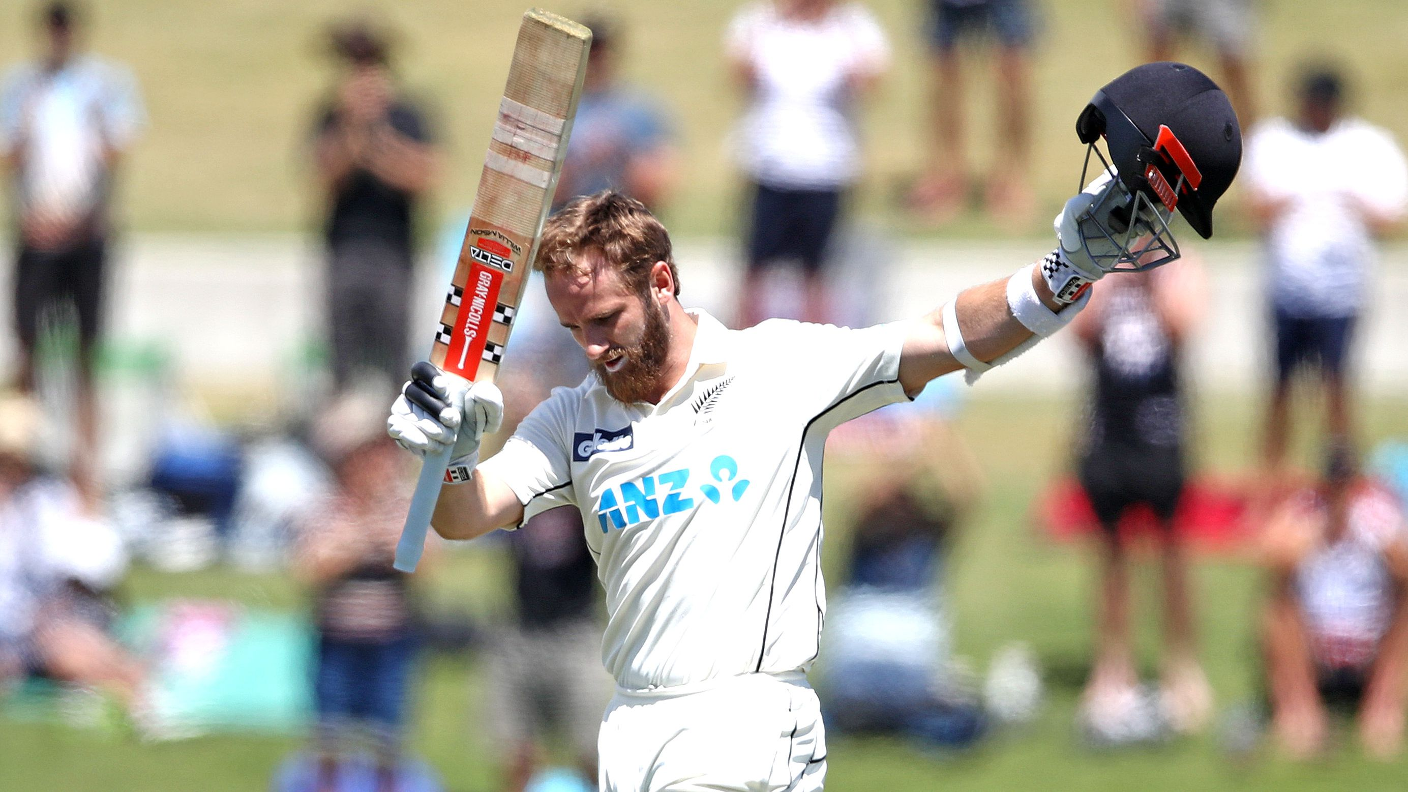 Kane Williamson of New Zealand acknowledges applause for his century.