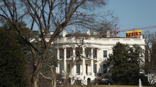 The banner is visible from the White House. (AAP)