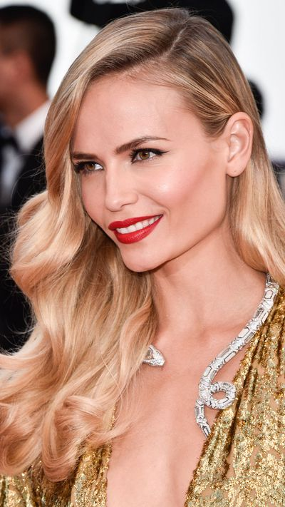 <p><strong>Day four</strong><br /><strong>Natasha Poly</strong> brought the heat with killer hair, a red lip and cheekbones to there.</p>