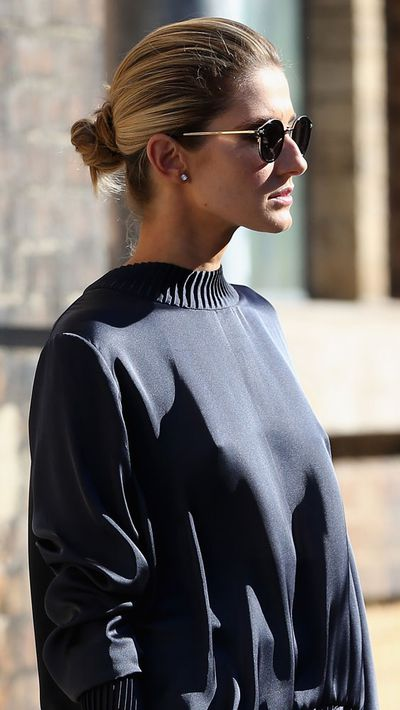 Brush your hair toward the back of your head and secure tightly with an elastic. Wrap your ponytail around itself, securing the bun with another elastic. Use a smoothing product or hairspray to tame any flyaways for a super-sleek office look.
