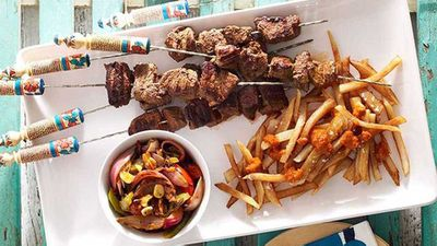 """<a href=""""http://kitchen.nine.com.au/2016/05/17/14/26/moroccan-beef-kebabs-with-harissa-chips-and-grilled-vegetable-salad"""" target=""""_top"""">Moroccan beef kebabs with harissa chips and grilled vegetable salad</a> recipe"""