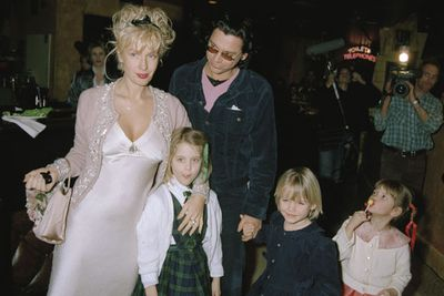 """In a telling interview about her mum's relationship with Hutchence in 2012, Peaches said: """"The transition of my mother who was amazing, who wrote books on parenting, who gave us this idyllic childhood in Kent; and who then turned into this heartbroken shell of a woman who was just medicating to get through the day.""""<br/><br/>(Image: Paula Yates, Michael Hutchence, Peaches Geldof and siblings in London, February 5, 1996. Source: Getty)"""