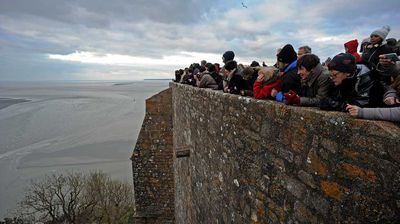 Others watched from the safer crowded ramparts of the granite islet, which is visited by three million people a year.<p></p>