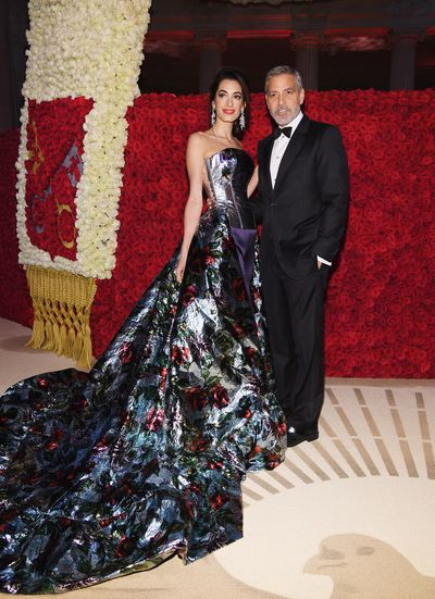 Human Rights lawyer Amal Clooney wearingRichard Quinn with actor husband George Clooney